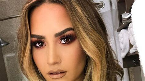 Demi Lovato awake in hospital after suspected heroin